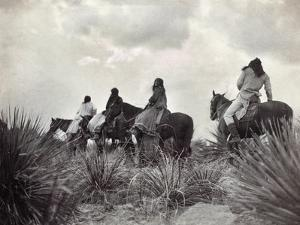 Apache on Horseback, c1906 by Edward S^ Curtis