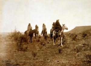 Apaches. Desert Rovers- Five Apache on Horseback in Desert, 1903 by Edward S^ Curtis