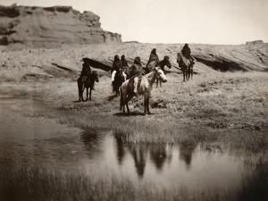 Navajo On Horseback, C1904 by Edward S^ Curtis