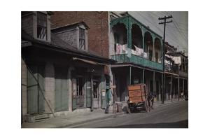 A Boy Sits on a Barrel Outside a Brewery in the French Quarter by Edwin L. Wisherd