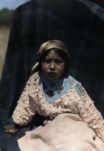 A Crow Indian Child Wears a Buckskin Dress of Beads and Teeth by Edwin L. Wisherd
