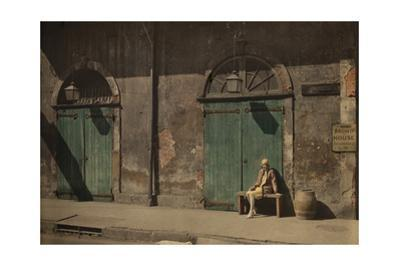 A Woman Sits Outside the Doorway of New Orlean's Absinthe House by Edwin L^ Wisherd
