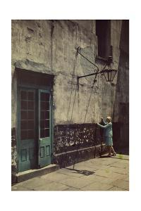 A Woman Touches the Wall of the Municipal Building for the Cabildo by Edwin L. Wisherd