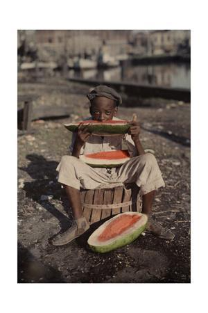 An Informal Portrait of a Young New Orleans Boy Eating Watermelon