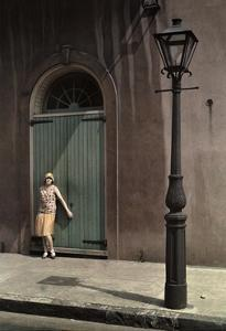 Woman Stands by the Doors of a Theater in the Old French Quarter by Edwin L. Wisherd