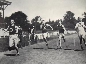 Arthur Duffey, American athlete, running a race, 1902 by Edwin Levick