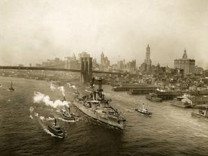 Battleship Wyoming Cruising Up the East River Escorted by Tugboats, Circa 1917 by Edwin Levick