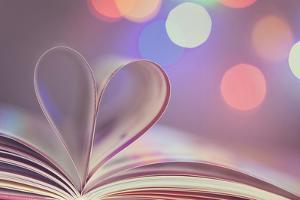 Book with Pages Folded into a Heart Shape by egal