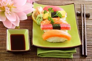 Japan Traditional Food Sushi on Green Plate by egal