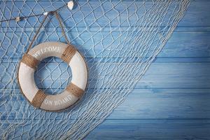 Life Buoy Decoration on Blue Shabby Background by egal