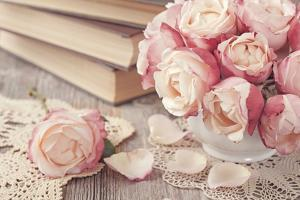 Pink Roses and Old Books on Wooden Desk by egal