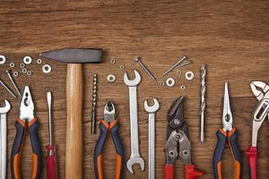 Set of Different Tools on Wooden Background by egal