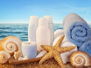 Spa Elements with White Towels,Candle and Brown Bottles by egal
