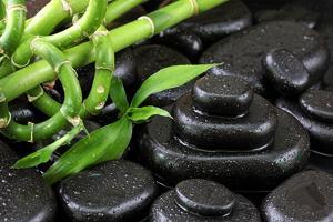 Spa Still Life with Hot Stones and Bamboo by egal