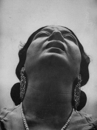 https://imgc.artprintimages.com/img/print/egyptian-actress-om-kalthoum-while-singing-on-cairo-s-voice-of-arabs-radio-show_u-l-p481et0.jpg?p=0