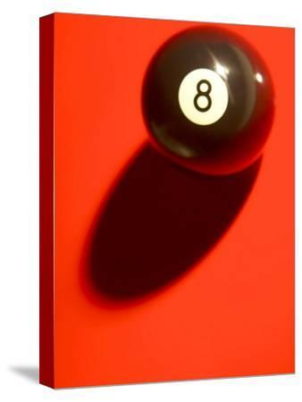 Eight Ball on with Shadow on Red Billard Table