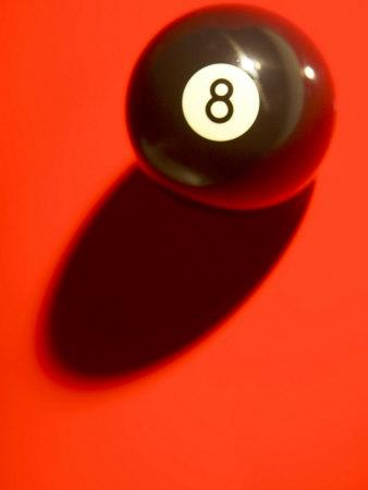 Eight Ball on with Shadow on Red Billard Table--Photographic Print