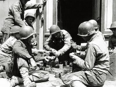 Eight U.S. Soldiers are Preparing Lunch at the Entrance of a House, Normandy, France, June 1944--Photographic Print