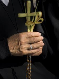 A Nun's Hands Holding Two Crosses Made of Palm Leaves, St. Anne Church, Israel by Eitan Simanor