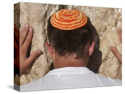 Close Up of Young Man with Bright Yarmulka Praying at Western Wall, Old City, Jerusalem, Israel