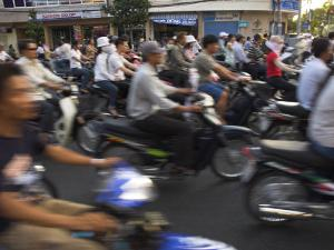 Crowd of People Riding Mopeds, Pham Ngu Lao Area, Ho Chi Minh City (Saigon), Vietnam by Eitan Simanor