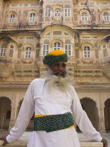 Elderly Museum Guard in White Uniform with Yellow and Green Turban, Meherangarh Fort by Eitan Simanor