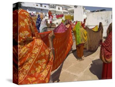 Group of Women Drying Their Saris by the Sacred Lake, Pushkar, Rajasthan State, India