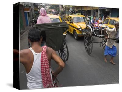 Hand Pulled Rickshaws and Yellow Taxis, Kolkata, West Bengal State, India