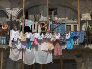 Large Quantity of Laundry Hanging from the Balcony of a Crumbling Building, Habana Vieja, Cuba by Eitan Simanor