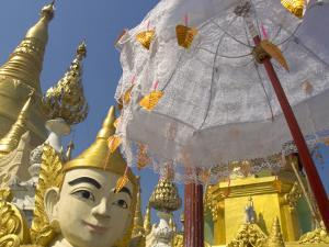 Mystical Figure, White Umbrella and Golden Stupas, Shwedagon Paya, Yangon, Myanmar by Eitan Simanor