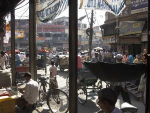 People and Vehicles in the Spice Market, Chandni Chowk Bazaar, Old Delhi, Delhi, India by Eitan Simanor