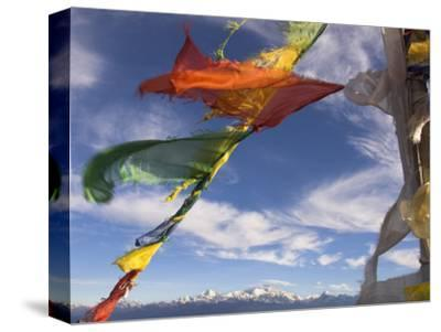 Prayer Flags with Snowy Kangchendzonga Beyond in Morning Light, Sandakphu, West Bengal State