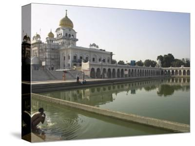 Sikh Pilgrim Bathing in the Pool of the Gurudwara Bangla Sahib Temple, Delhi, India
