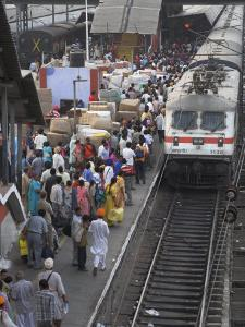 Train Ariving at Crowded Platform in New Delhi Train Station, Delhi, India by Eitan Simanor