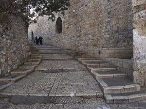 Two Palestinian Women Walking Down a Street Along the City Walls, Old City, Jerusalem, Israel by Eitan Simanor