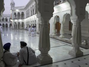 Two Sikhs Priests at Dawn Sitting Under Arcades, Golden Temple, Amritsar, Punjab State, India by Eitan Simanor
