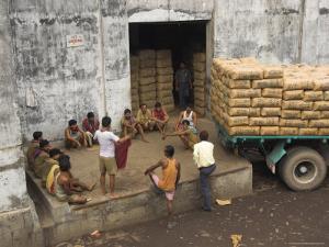 Warehouse Workers Having Rest Break at Carrit Moran & Company's Tea Warehouses at Kolkata Port by Eitan Simanor