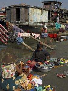 Women Washing Their Laundry on Bank of the Ayeryarwady River, Mandalay by Eitan Simanor