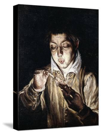 A Boy Lighting a Candle