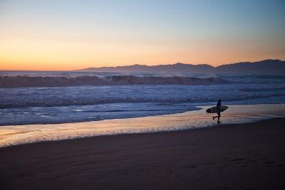 El Porto Beach, Los Angeles, California, USA: A Surfer Exits the Waves at Dusk-Ben Horton-Photographic Print