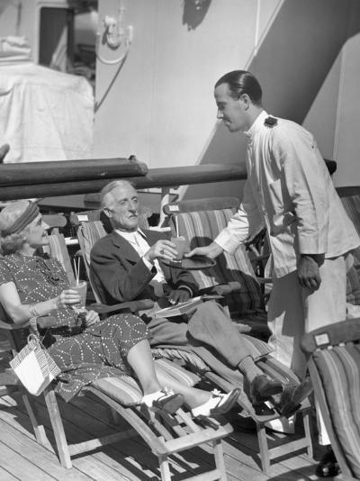 Elderly Couple Being Served Drinks on Deck of Cruise Ship-George Marks-Photographic Print