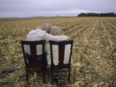 Elderly Couple Embrace in a Cornfield-Joel Sartore-Photographic Print