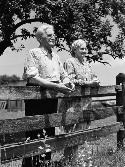 Elderly Couple on Farm Standing at Wooden Fence Looking Off Into Distance-H^ Armstrong Roberts-Photographic Print