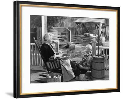 Elderly Couple on Porch of Farmhouse--Framed Photo