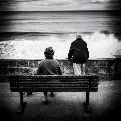 Elderly Couple Watch the Waves-Rory Garforth-Photographic Print