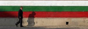 Elderly Man Passes a National Flag Painted on Front of a Polling Station in Bulgarian Capital Sofia