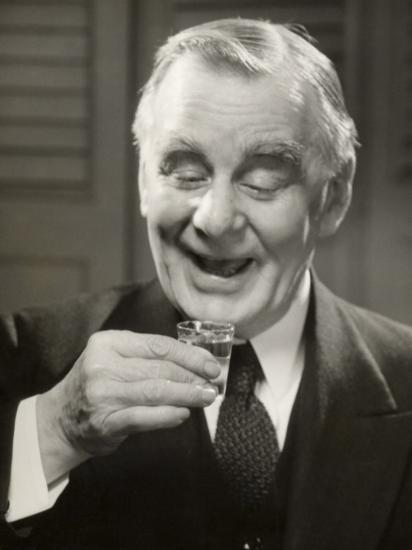 Elderly Man Raising Glass of Whiskey-George Marks-Photographic Print