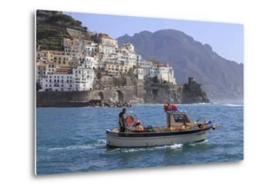 Fisherman in Fishing Boat Heads Out to Sea from Amalfi Harbour