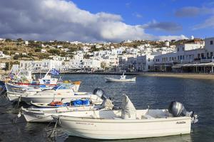 Small boats in harbour, whitewashed Mykonos Town (Chora) with windmills on hillside, Mykonos, Cycla by Eleanor Scriven
