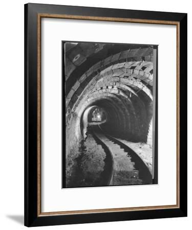 Electric Locomotive on Track in Powderly Anthracite Coal Mine Gangway, Owned by Hudson Coal Co-Margaret Bourke-White-Framed Premium Photographic Print